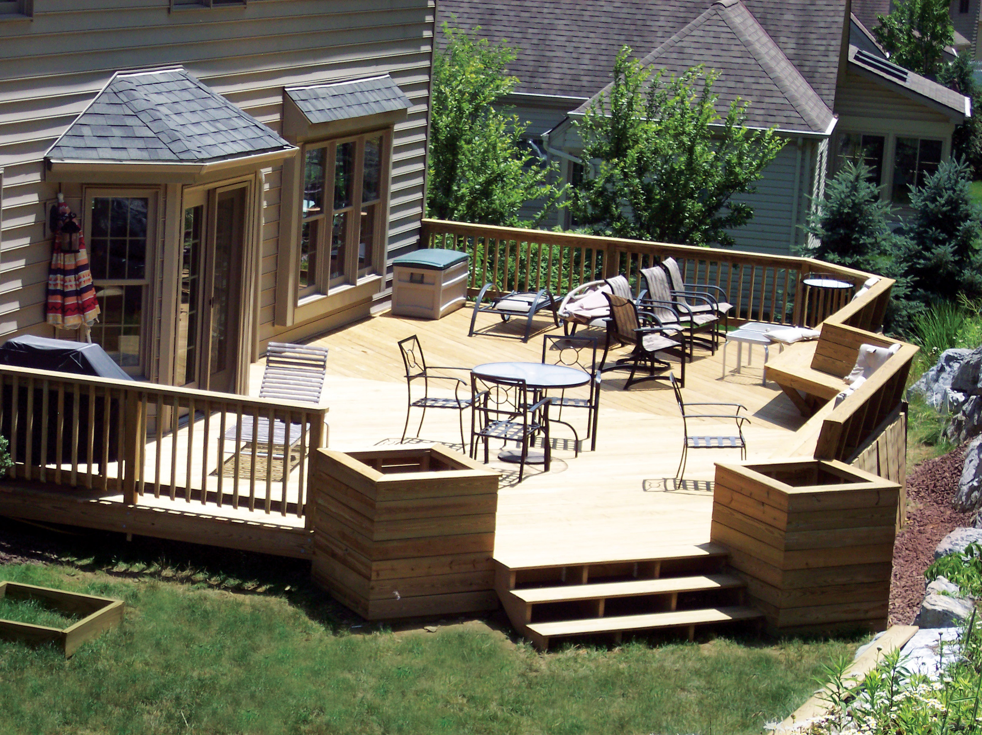 Your decking material options pros and cons lancaster for Exterior deck design